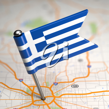 Small Flag of Hellenic Republic of Greece on a Map Background with Selective Focus.