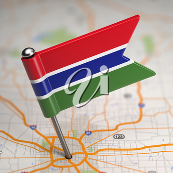 Small Flag of Gambia on a Map Background with Selective Focus.
