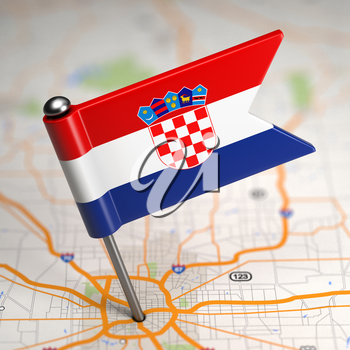 Small Flag of Croatia on a Map Background with Selective Focus.