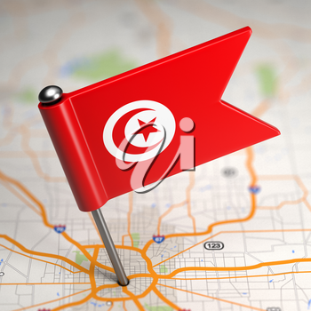 Small Flag of Tunisia on a Map Background with Selective Focus.