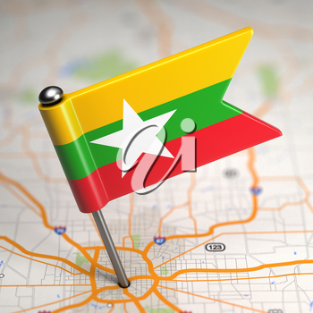 Small Flag of Myanmar on a Map Background with Selective Focus.