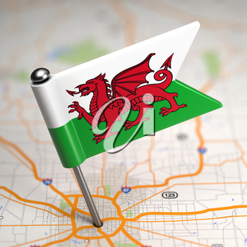 Small Flag of Wales on a Map Background with Selective Focus.