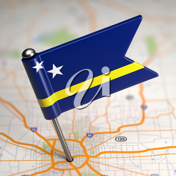 Small Flag of Curacao on a Map Background with Selective Focus.