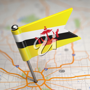 Small Flag of Nation of Brunei, Abode of Peace on a Map Background with Selective Focus.