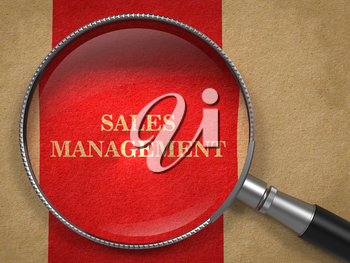 Sales Management. Magnifying Glass on Old Paper with Red Vertical Line.