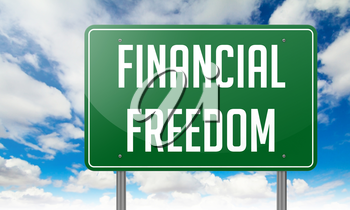 Highway Signpost with Financial Freedom wording on Sky Background.