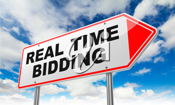 Real Time Bidding - Inscription on Red Road Sign on Sky Background.