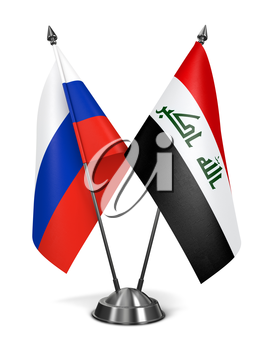 Russia and Iraq - Miniature Flags Isolated on White Background.