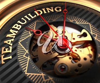 Teambuilding on Black-Golden Watch Face with Closeup View of Watch Mechanism.