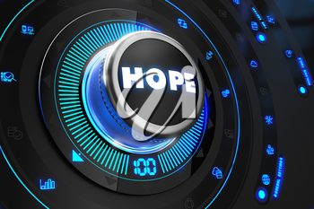 Hope Button with Glowing Blue Lights on Black Console.