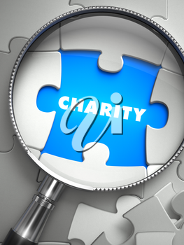 Charity - Puzzle with Missing Piece through Loupe. 3d Illustration with Selective Focus.