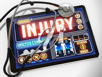 Injury - Diagnosis on the Display of Medical Tablet and a Black Stethoscope on White Background.