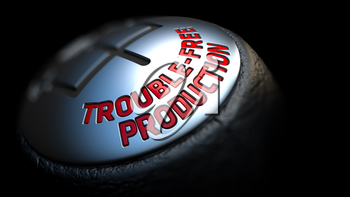 Trouble-Free Production - Red Text on Car's Shift Knob on Black Background. Close Up View. Selective Focus.