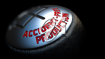 Accident-Free Production - Red Text on Cars Shift Knob on Black Background. Close Up View. Selective Focus.