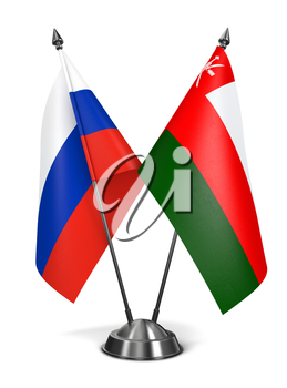 Russia and Oman - Miniature Flags Isolated on White Background.