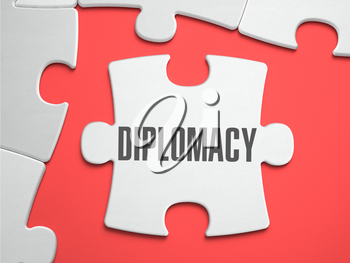 Diplomacy - Text on Puzzle on the Place of Missing Pieces. Scarlett Background. Close-up. 3d Illustration.