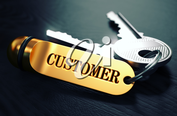 Customers Concept. Keys with Golden Keyring on Black Wooden Table. Closeup View, Selective Focus, 3D Render. Toned Image.