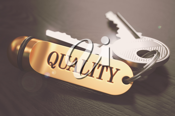 Keys to Quality - Concept on Golden Keychain over Black Wooden Background. Closeup View, Selective Focus, 3D Render. Toned Image.
