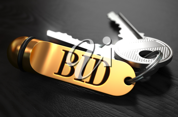 Keys with Word  Bid on Golden Label over Black Wooden Background. Closeup View, Selective Focus, 3D Render.