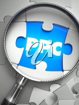 PPC - Word on the Place of Missing Puzzle Piece through Magnifier. Selective Focus.