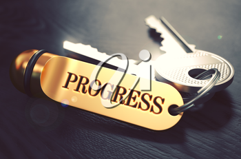 Progress - Bunch of Keys with Text on Golden Keychain. Black Wooden Background. Closeup View with Selective Focus. 3D Illustration. Toned Image.