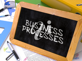 Hand Drawn Business Processes Concept  on Chalkboard. Blurred Background. Toned Image.