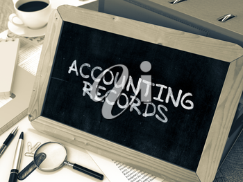 Hand Drawn Accounting Records Concept  on Chalkboard. Blurred Background. Toned Image.