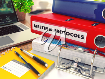 Meeting Protocols - Red Office Folder on Background of Working Table with Stationery, Laptop and Reports. Business Concept on Blurred Background. Toned Image.