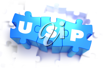 USP - Unique Selling Point - White Word on Blue Puzzles on White Background. 3D Illustration.