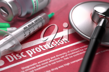 Disc protrusion - Medical Concept on Red Background with Blurred Text and Composition of Pills, Syringe and Stethoscope.