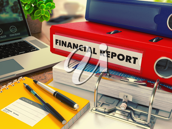 Red Office Folder with Inscription Financial Report on Office Desktop with Office Supplies and Modern Laptop. Business Concept on Blurred Background. Toned Image.