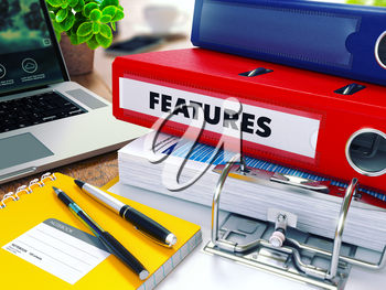 Features - Red Ring Binder on Office Desktop with Office Supplies and Modern Laptop. Business Concept on Blurred Background. Toned Illustration.