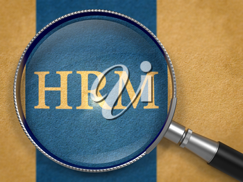 HRM - Human Resources Management - through Magnifying Glass on Old Paper with Dark Blue Vertical Line Background.