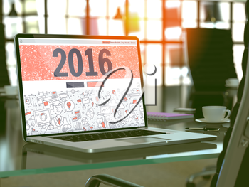 2016 Concept. Closeup Landing Page on Laptop Screen in Doodle Design Style. On background of Comfortable Working Place in Modern Office. Blurred, Toned Image.