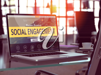 Social Engagement Concept. Closeup Landing Page on Laptop Screen  on background of Comfortable Working Place in Modern Office. Blurred, Toned Image.