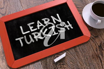 Learn Turkish Handwritten on Red Chalkboard. Business Concept. Composition with Chalkboard and Cup of Coffee. Top View Image. 3d Render.