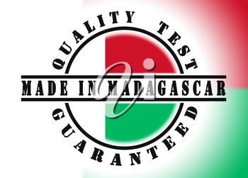 Quality test guaranteed stamp with a national flag inside, Madagascar