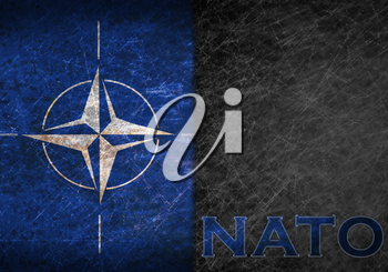 Old rusty metal sign with a NATO flag and abbreviation