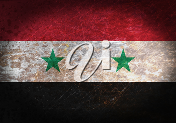 Old rusty metal sign with a flag - Syria