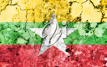 Old cracked wall with painted flag, flag of Myanmar