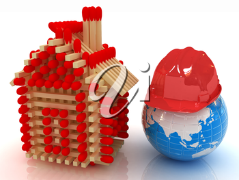 Log house from matches pattern on white and hard hat on earth