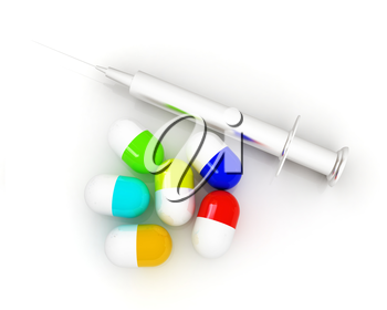Pills and syringe on a white background