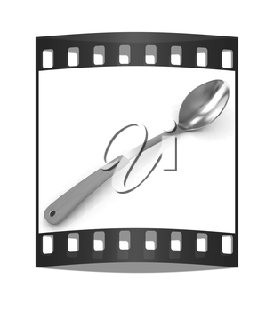 Gold long spoon on a white background. The film strip