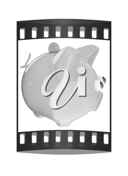 Piggy bank with gold coin on white. The film strip