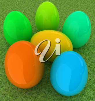 Colored Easter eggs on a green grass