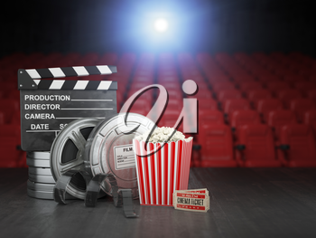 Cinema, movie or home video concept background. Film reels, clapper board  and pop corn in the theater movie cinema screen with empty seats. 3d illustration