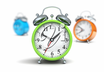 Green alarm clock front orange and blue out of focus