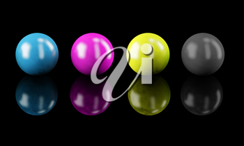 Set of balls isolated on black: CMYK colors