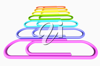 Colored paperclips laid out in a line isolated on white background close-up perspective view