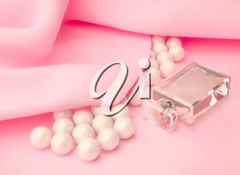 Perfume in a glass bottle and pearl beads on pink silk.
